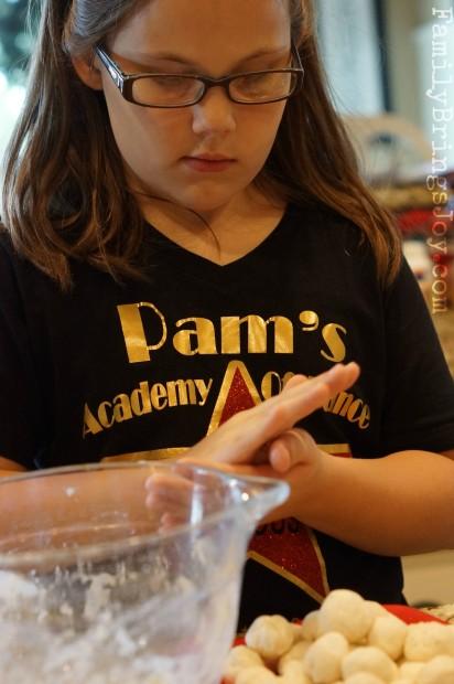 girl rolling dumplings familybringsjoy.com