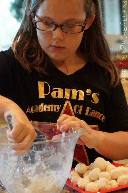 girl scooping dumpling dough familybringsjoy.com